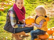 woman and child at pumpkin patch during fall festival on original orlando tours