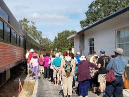 guests board the royal pizza express train tour during an original orlando tours visit to historic mount dora florida