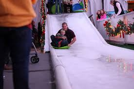christmas fun starts with a trip on the ice slide during an original orlando tours visit to light up ucf