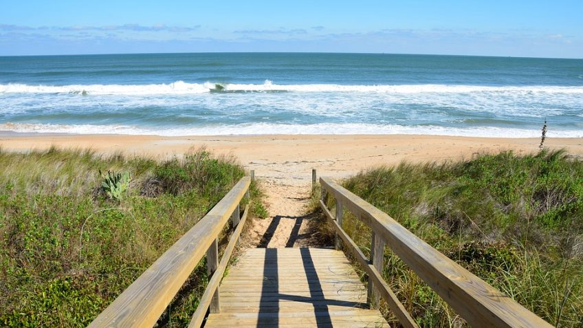 this walkway leads to the sun and sand of one of florida's most beautiful beaches experienced during an original orlando tours visit to the cape canaveral beach