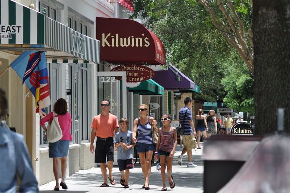 family walking and shopping on park avenue in historic winter park during original orlando tours