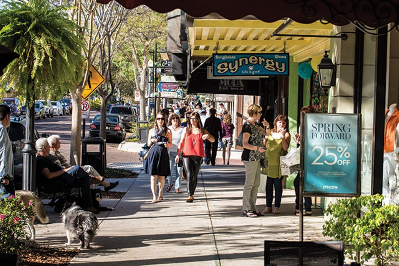 friends walking and shopping on park avenue in historic old world winter park during original orlando tours